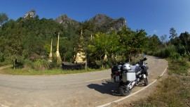 Buddhist monument by lake/mountain